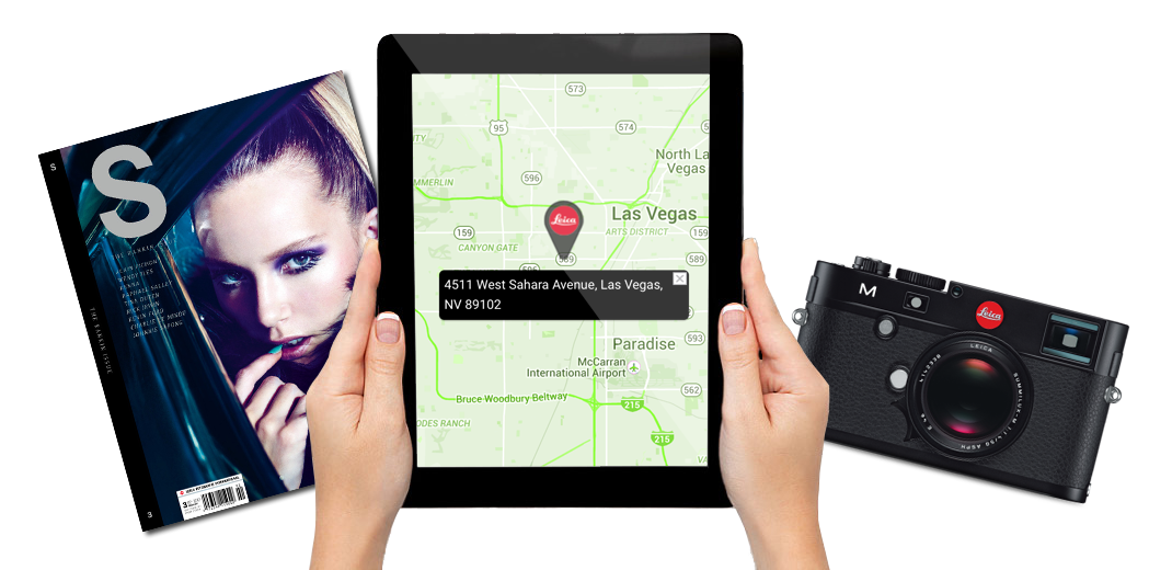 Leica Boutique Las Vegas Visit Us Lade Holding an iPad displaying the map location